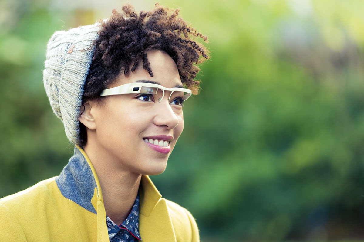 Woman with wearable computer in form of smart glasses.